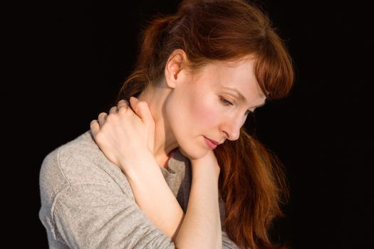 Scared woman holding herself