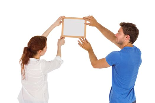 Couple deciding to hang picture