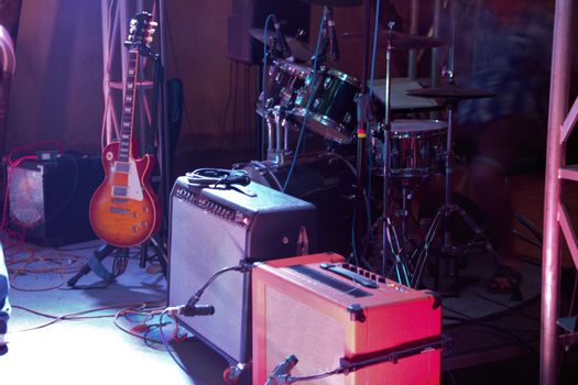 drums, guitar and amps back line at gig on stage