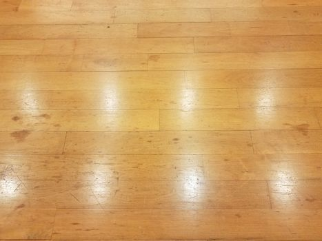 brown wood floor with glare or reflection