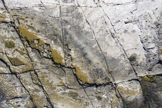 an aerial view of flat cracked rocky cliffs near sea, Duga Uvala, Istria, Croatia
