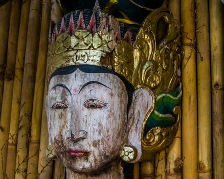 the face of a traditional asian wooden sculpture, Spiritual statue, Asian culture