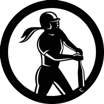 Mascot icon illustration of a female softball player batting with bat set inside circle viewed from side on isolated background in retro style done in black and white.