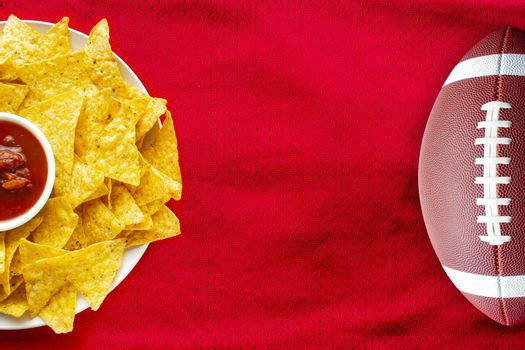 American Football Jersey textured with a football and nachos with a salsa dip on a horizontal view