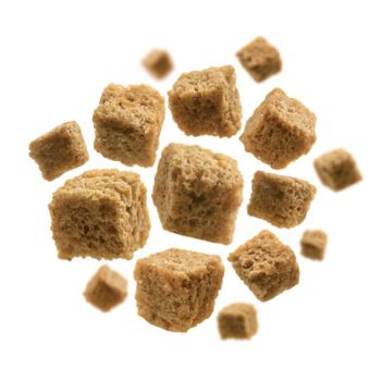 Bread croutons levitate on a white background.