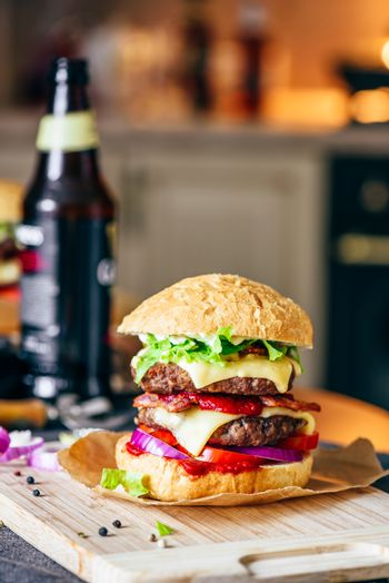 Cheeseburger with  Bottle of Beer and Some Ingredients.