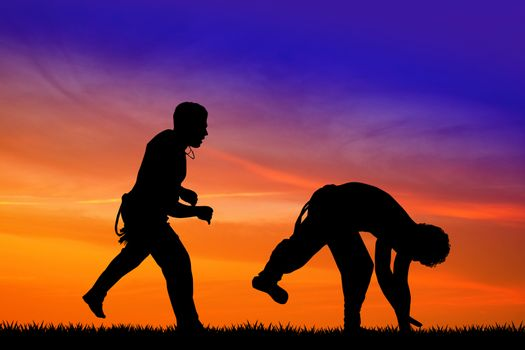 capoeira discipline at sunset