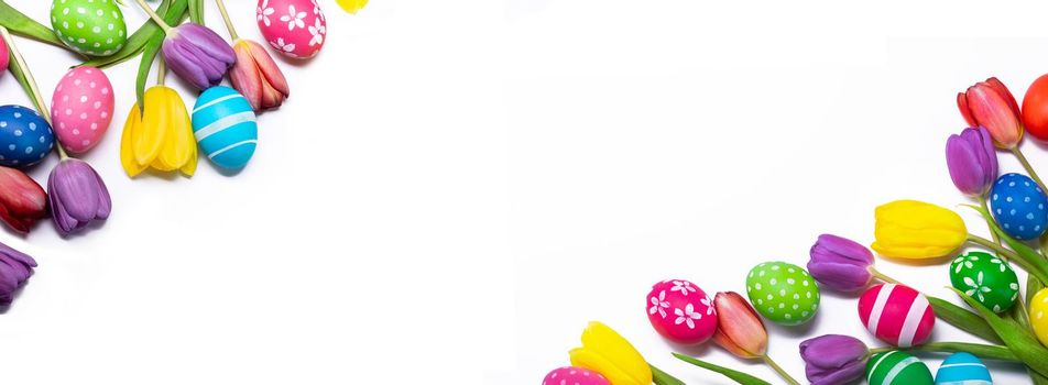 Hand-painted easter eggs with tulips isolated on white background frame with copy space for text