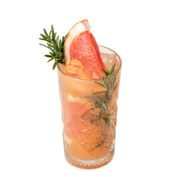 Cold cocktail drink with slice of grapefruit and rosemary
