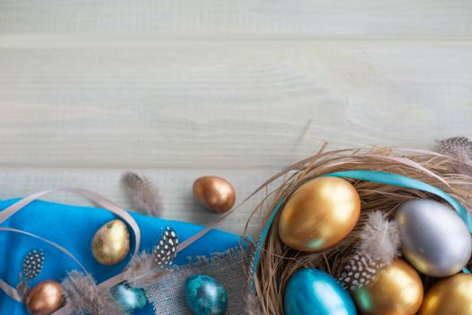 Happy Easter border frame with copy space for text top view flat lay of easter nest fith eggs feathers ribbons bows and fabric folded to rabbit ears