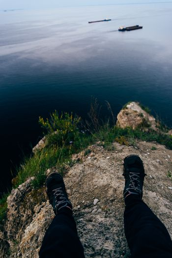 Person sitting on the edge