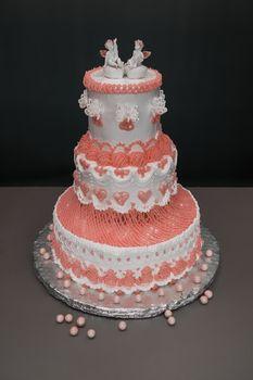 Wedding cake with angels on grey background