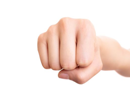 Close up of a female fist punching the camera, isolated on white background. Front view.