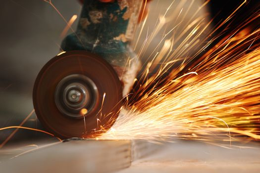 metal sawing close up sparks spray industry manufacturing