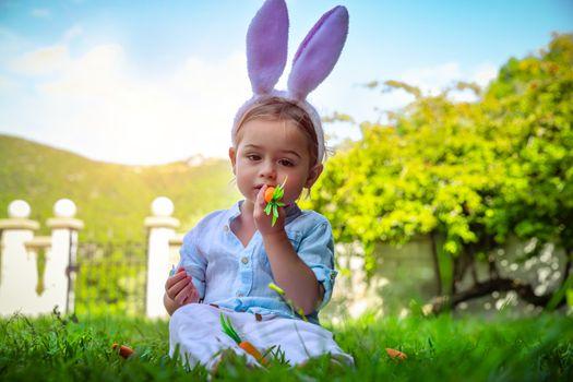 Easter bunny eating carrot