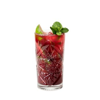Cold multi fruit cocktail drink with slices of lime, mint leaf isolation on a white