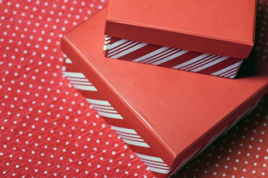 Christmas gift boxes on a red wrapping paper