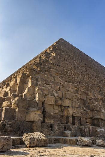 Bottom up view of the Great Pyramid of Giza on a clear sunny day