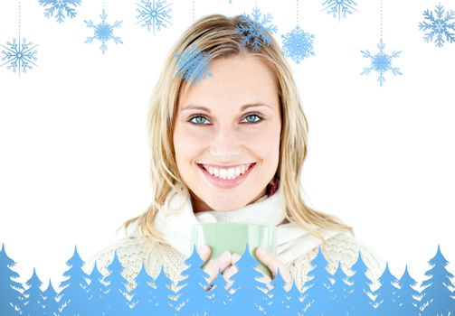 Composite image of smiling blond woman wearing a pullover and holding a cup of coffee