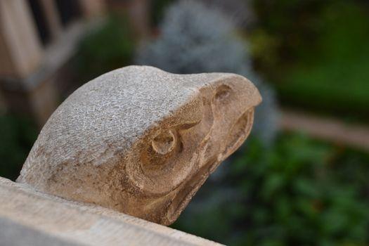 Stone gargoyle representing the head of an eagle