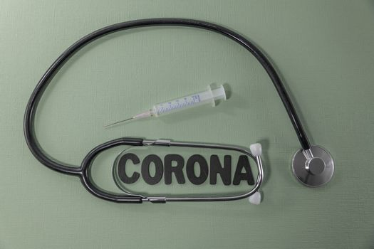 Covid 19 virus conceptual image with text in black and green and stethoscope