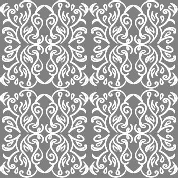 Vintage victorian wallpaper with white ornate tracery on grey background