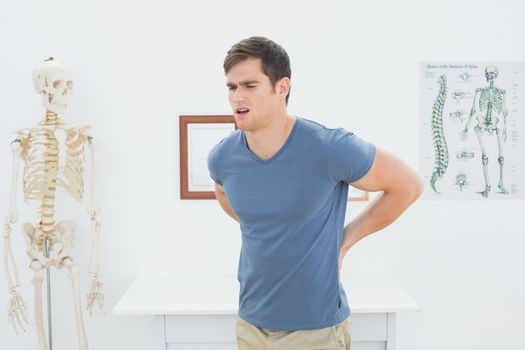Man with back pain in medical office