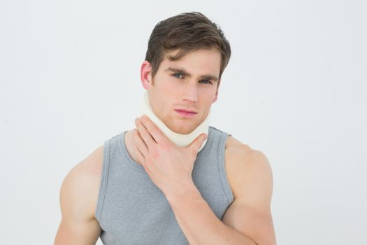 Portrait of a young man wearing cervical collar