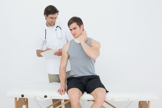 Male doctor listening to patient with concentration