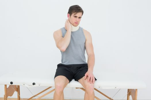 Handsome young man wearing cervical collar