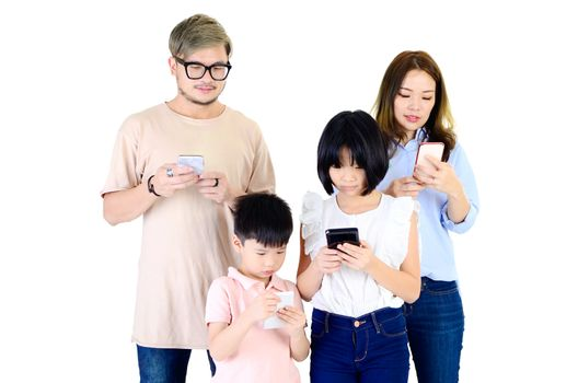 Asian family members spending time playing with smartphones
