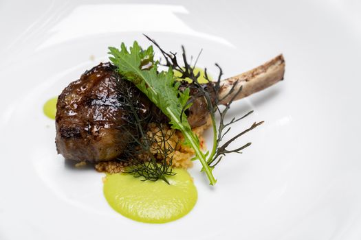 Grilled lamb chop with pesto sauce, international gourmet cuisine a la carte in buffet live station. Using for food and drink industry.