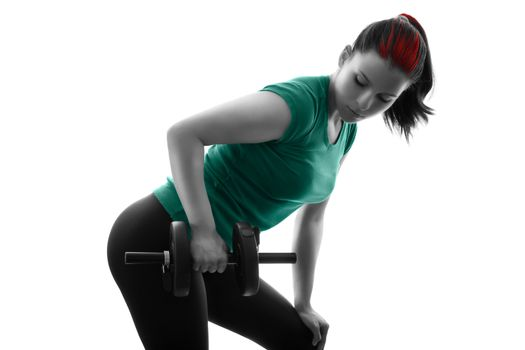 Fit attractive young woman working out with a set of dumbbells, doing bent-over row, backlit silhouette studio shot isolated on white background. Fitness and healthy lifestyle concept.