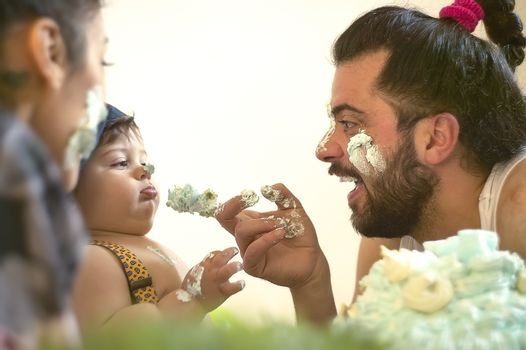 Dad plays with his baby with love at home