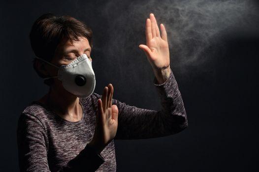 Woman Wearing Medical Protective Virus Mask on dark background