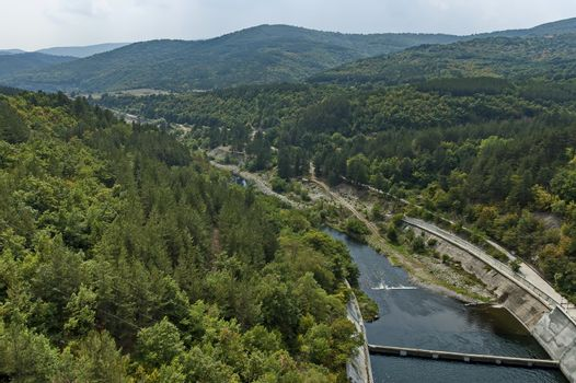 View of the old small hydro power plant and Topolnitsa dam  on the river Topolnitsa near village Muhovo, Ihtiman region, Bulgaria, Europe