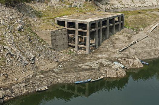 View from Topolnitsa dam, lake or barrage on the river Topolnitsa and old abandoned construction near village Muhovo, Ihtiman region, Bulgaria, Europe