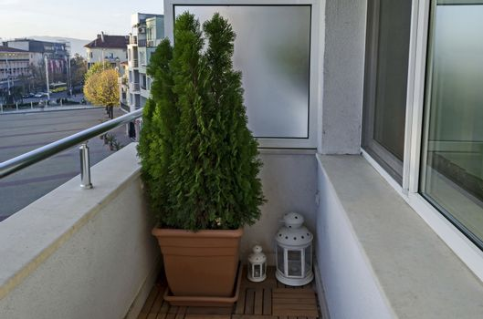 Balcony of a new apartment with  cypress flower in pot and lamp, town Kazanlak, Bulgaria