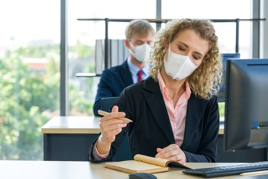 Reduce the spread of Coronavirus disease 2019 (COVID-19) in the office. Ways to prevent the transmission of disease can be done by wearing a surgical mask.