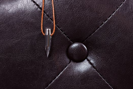 bullet lucky charm on leather couch