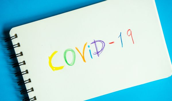COVID-19 virus concept with safe notes on pastel blue background with copy space