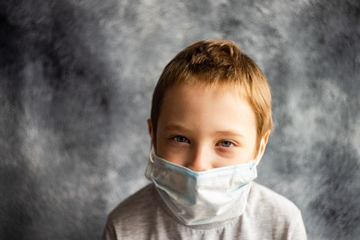 COVID-19 virus concept with boy in face mask