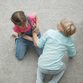 Struggle between two children conflict fighting family concept