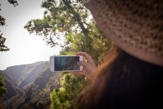 young girl photographs with her cellphone, La Palma Canary Islands