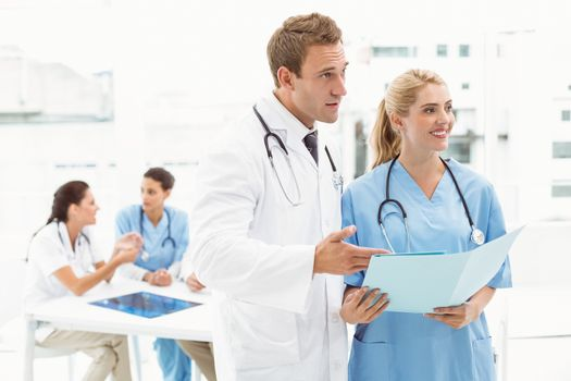 Male doctor and surgeon with reports