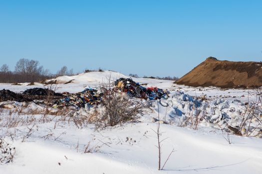 Plastic pollution or unauthorized dumping concept in a landfill garbage