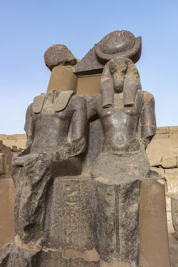 Statues of goddess Ma'at and god Toth made from Egyptian red granite in the Mortuary Temple of Ramesses III