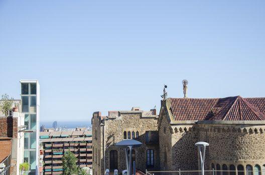 Roofs of old narrow street of european city. Barcelona, Spain.