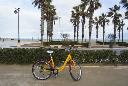 A bicycle parked in the seafront of the popular La Malvarrosa beach, in Valencia, Spain.