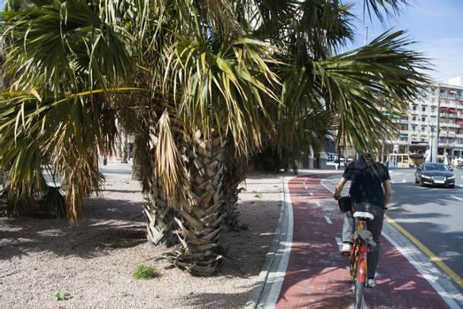 Cyclist rides through the streets of Valencia, Spain.